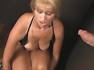Slim Blonde In Heats Kneels To Suck Giant Cock Through A Hole
