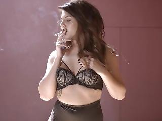 Briony Smoking In Lingerie And Stockings