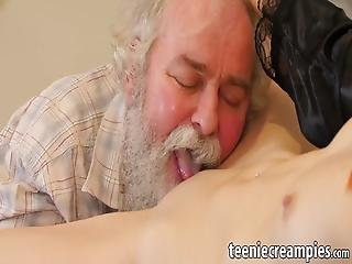 Redhead Teenie Lays Down And Lifts Her Legs Up For Old Man