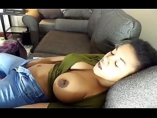 Seductive Ebony With Big Boobs Sucks Dildo