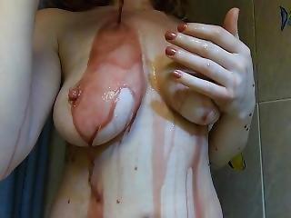 Blockbuster Ginger Teen Teasing Large Natural Breasts Under Red Wine Shower