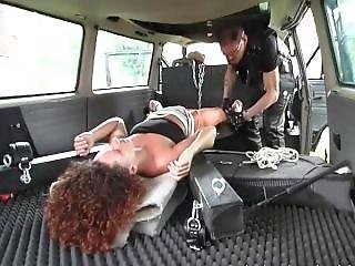 Redhead Babe Tied In Car Gives Nice Head