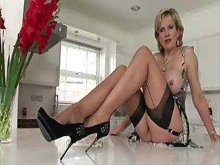 British Lady On A Table Writing A Book In Lingerie And Stockings
