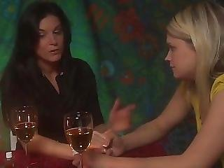A Pretty Blonde Is Seduced By A Sexy Brunette Woman
