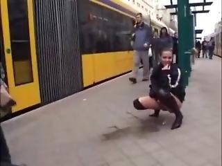 A Girl Flashes And Pisses In Public At The Bus Station